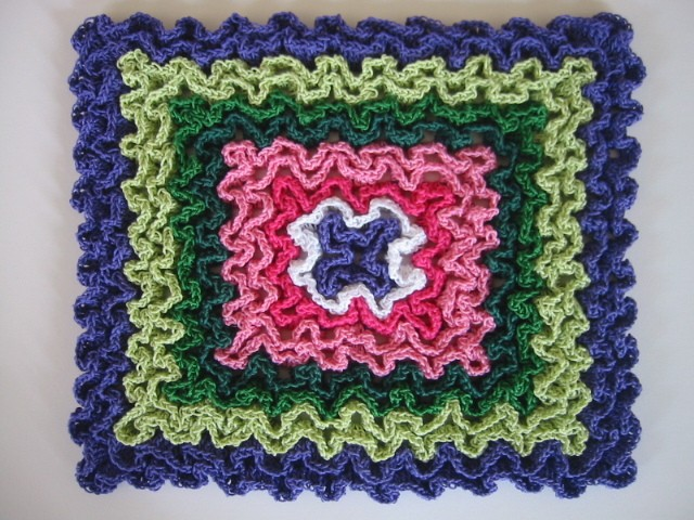 [Free Pattern] These Hot Pads Are Crocheted In Rug Yarn For Thick, Heat-Proof Protection