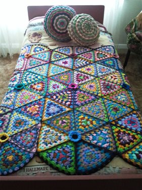 afghan and cushion