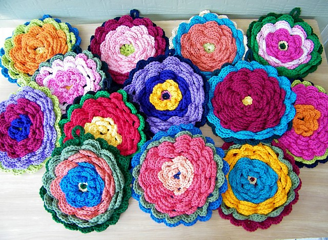 Fanciful Flower Potholders by Claudia Lowman