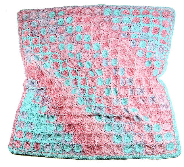 [Free Pattern] Let The Yarn Work Its Magic On Its Own To Create This Spectacular Baby Blanket